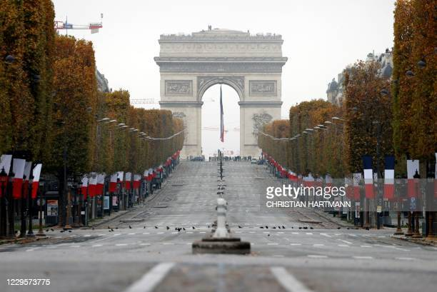 General view of the Champs-Elysees avenue with the Arc de Triomphe in the background during Armistice Day commemorations marking the 102nd...