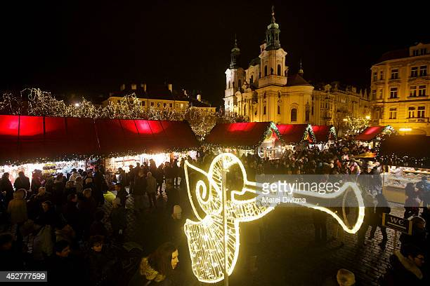 General view of the Christmas market at the Old Town Square on December 1 2013 in Prague Czech Republic Christmas markets traditionally selling...