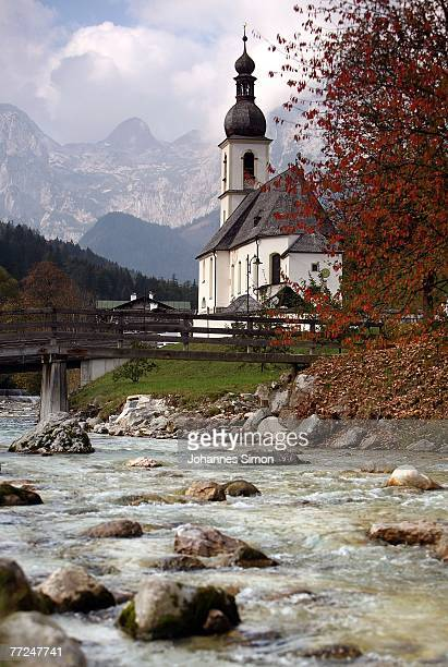 General View of the church St Sebastian in front of the Reiteralpe mountains seen on October 10 2007 in Ramsau near Berchtesgaden Germany Weather...