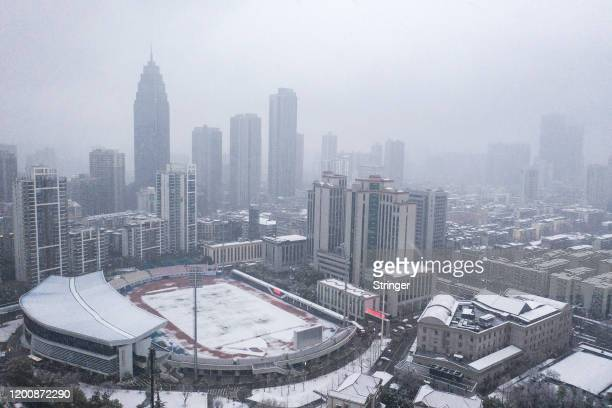 General view of the city as snow falls on February 15, 2020 in Wuhan, Hubei, China. Flights, trains and public transport including buses, subway and...