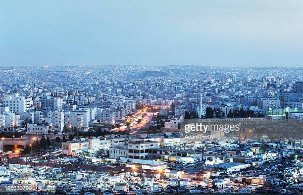 A general view of the city of Amman at twighlight on March 26 2013 in Amman Jordan