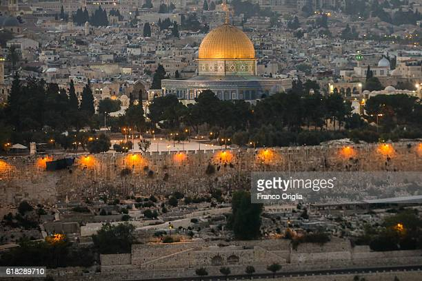 A general view of the city of Jerusalem and the Dome of the Rock shrine at sunset taken from the Mount of Olives on October 25 2016 in Jerusalem...