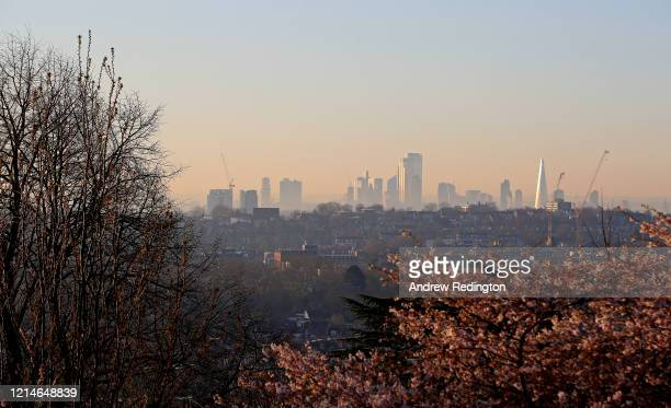 A general view of the City of London from Alexandra Palace at sunrise on March 25 2020 in London England Coronavirus has spread to at least 194...