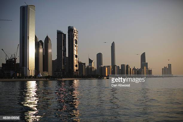 General view of the city skyline at sunset from Dhow Harbour on February 5, 2015 in Abu Dhabi, United Arab Emirates. Abu Dhabi is the capital of the...