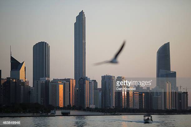 A general view of the city skyline at sunset from Dhow Harbour on February 5 2015 in Abu Dhabi United Arab Emirates Abu Dhabi is the capital of the...