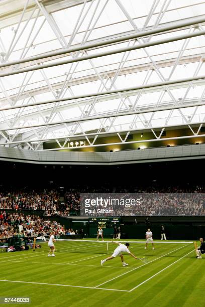 General view of the closed centre court roof during the Mixed Doubles match of Andre Agassi and Steffi Graf against Tim Henman and Kim Clijsters...