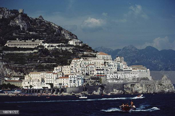 General view of the coastal town of Amalfi on the Sorrento Peninsula with boats along the bay Italy in August 1984