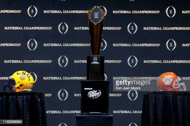 A general view of The College Football Playoff National Championship Trophy with both LSU Tigers and Clemson Tigers helmets on both sides before the...