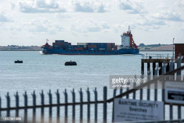 General view of the container ship Ranger Limassol sailing along the river Thames estuary on August 2, 2021 in Canvey Island, United Kingdom.
