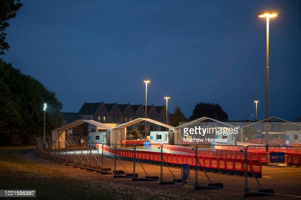 A general view of the coronavirus drivethrough testing centre at the Cardiff City Stadium at dusk on April 27 in Cardiff Wales As the UK reports the...