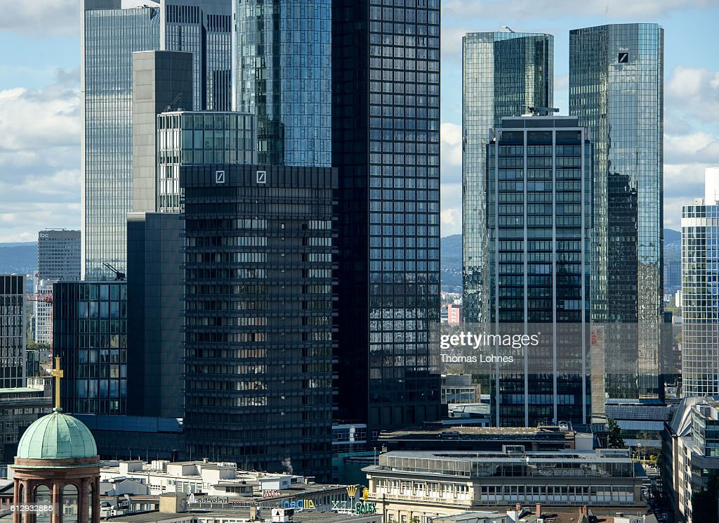 A general view of the corporate headquarters of Deutsche Bank (R) and the finance district of Frankfurt on October 5, 2016 in Frankfurt, Germany. Banks across Europe are struggling as their profits have fallen amid an ongoing period of low interest rates, and many, including Commerzbank and Deutsche Bank of Germany, ING and ABN Amro of Holland, and Banco Popular of Spain, are responding by slashing thousands of jobs in an effort to cut costs.