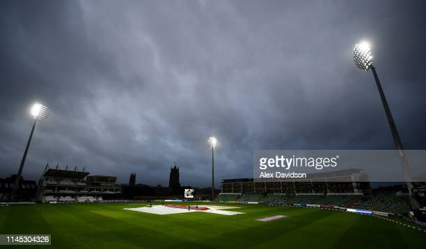 General view of the covers as play is delayed during the Royal London One Day Cup match between Somerset and Essex at The Cooper Associates County...