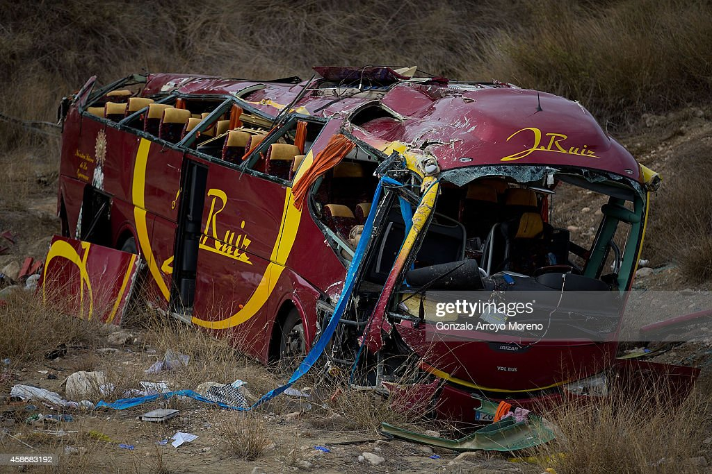 A general view of the crashed bus in which 13 people died on November 9, 2014 in Venta del Olivo, at Murcia province, Spain. Thirteen people were killed and 42 injured after their bus fell 15 meters from Calasparra road. The travellers were returning from Madrid to the Murcian town of Bullas after attending a religious ceremony at the Convent of the Barefoot Carmelites.