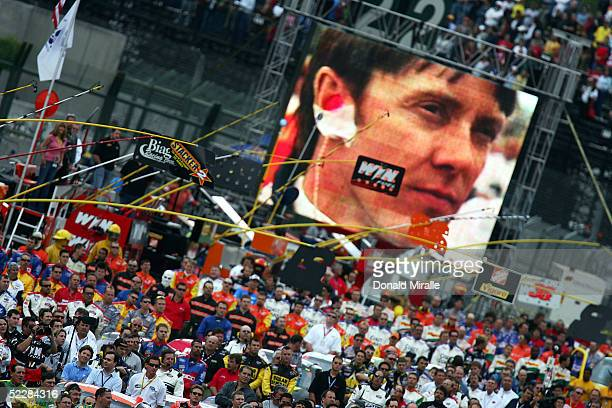 General view of the crews lined up as Adrian Fernandez of Mexico, driver of the Lowe's Hatachi Power Tools Chevrolet Monte Carlo, is seen on the...