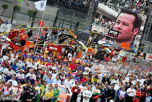 A general view of the crews lined up as Robby Gordon driver of the Red Bull Chevrolet Monte Carlo is seen on the Trinitron screen before the start of...