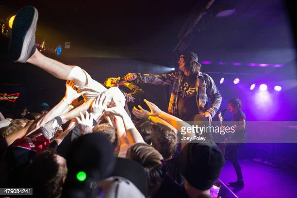 A general view of the crowd and band has a crowd surfer sings along with the band Tear Out The Heart performs live onstage during Tyler Konersman's...