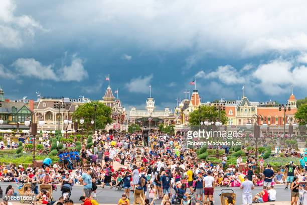 General view of the crowd and buildings in the Walt Disney Magic Kingdom park. The themed park is a major tourist attraction in the state of Florida.
