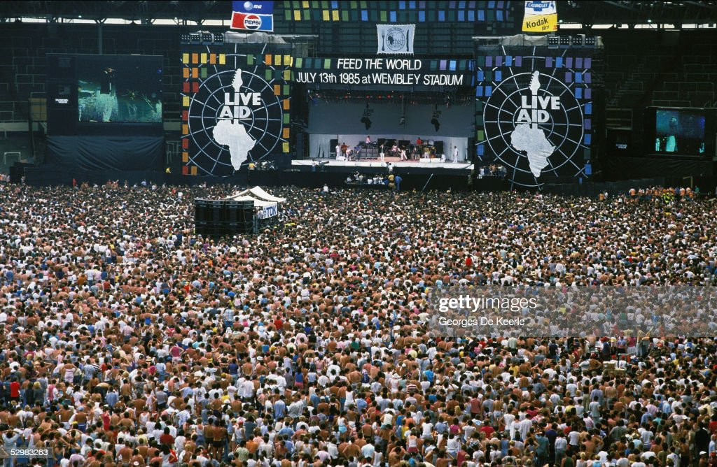 A general view of the crowd and stage during the Live Aid concert at Wembley Stadium on 13 July, 1985 in London, England. Live Aid was watched by millions around the world on television and raised vast quantities of donated money to help relieve a severe famine in Ethiopia.