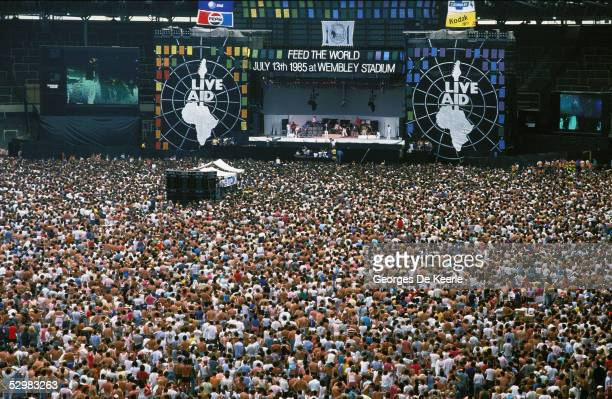 General view of the crowd and stage during the Live Aid concert at Wembley Stadium on 13 July, 1985 in London, England. Live Aid was watched by...