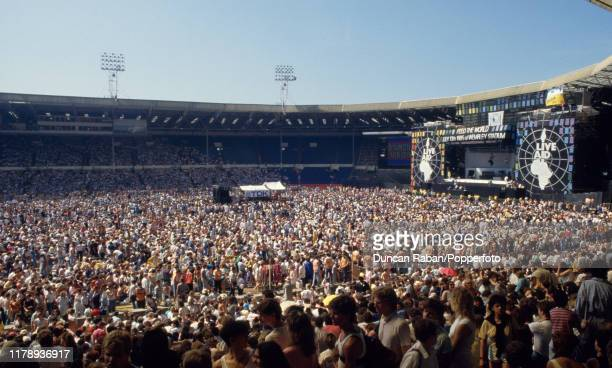A general view of the crowd and the stage at Wembley stadium during the Live Aid concert in London England on July 13 1985 Live Aid was a charity...