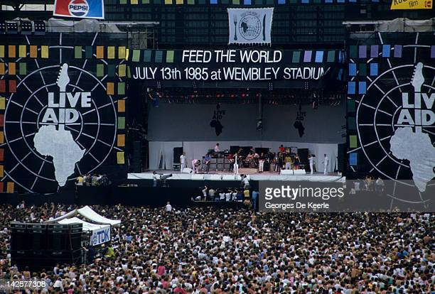 General view of the crowd and the stage during the Live Aid concert at Wembley Stadium in London, 13th July 1985. The concert raised funds for famine...