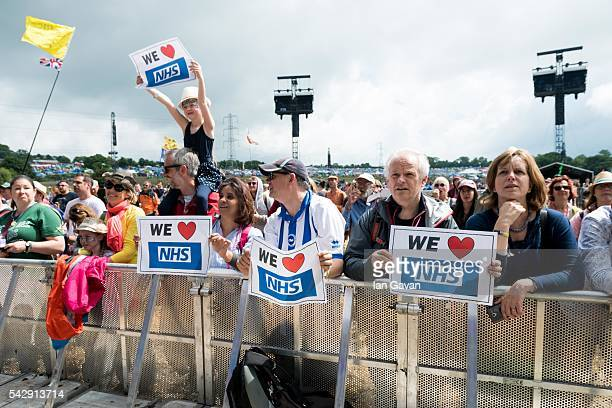 General view of the crowd as the Lewisham and Greenwich NHS Choir perform on the Pyramid Stage on day 2 of the Glastonbury Festival at Worthy Farm...