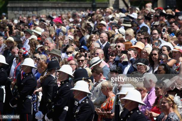General view of the crowd at the wedding of Prince Harry to Ms Meghan Markle at St George's Chapel, Windsor Castle on May 19, 2018 in Windsor,...