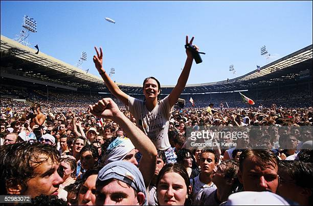 General view of the crowd during the Live Aid concert at Wembley Stadium on 13 July, 1985 in London, England. Live Aid was watched by millions around...