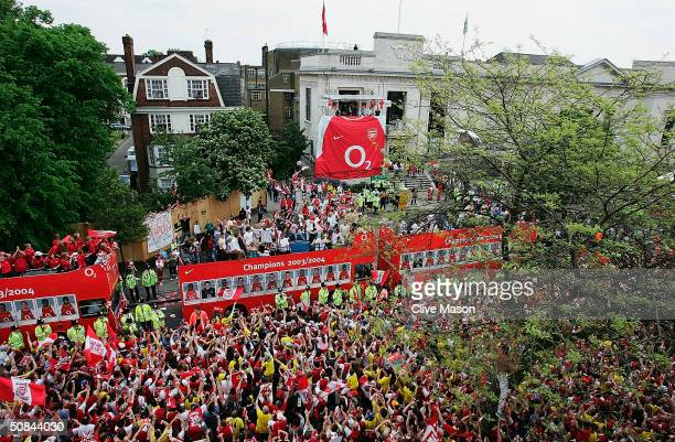 General view of the crowd is seen as the Arsenal team busses arrive at the Islington Town Hall during the Arsenal Football Club victory parade to...