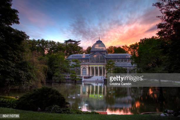 CONTENT] General view of the Crystal Palace in Retiro Park in Madrid at sunset