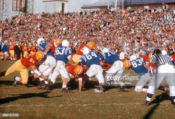 General view of the Denver Pioneers running the ball as the Air Force Falcons play defense during an NCAA game on November 8, 1958 at DU Stadium in...