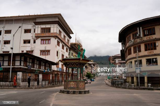 TOPSHOT General view of the deserted Norzin Lam road Bhutan's capital main artery during a government imposed nationwide lockdown as a preventive...