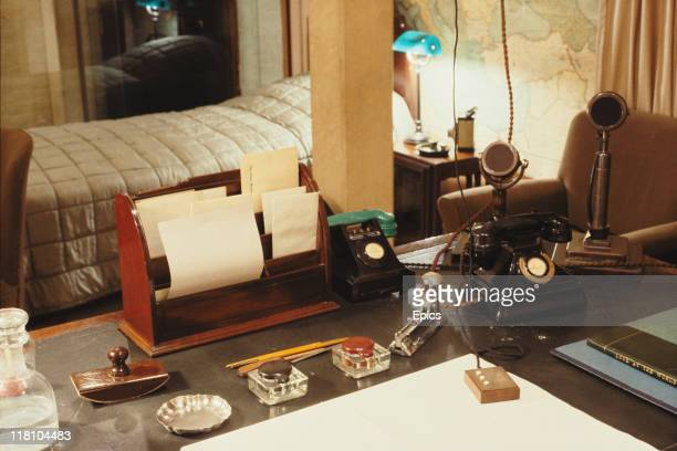 General view of the desk and bedroom of British Prime Minister Winston Churchill at the cabinet war rooms, London, circa 1990. The microphones were...