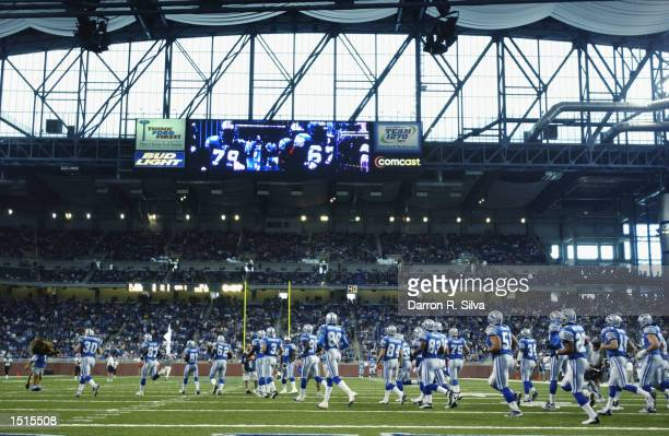 A general view of the Detroit Lions as they run onto the field before the game against the New Orleans Saints on September 29 2002 at Ford Field in...
