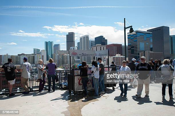 A general view of the Downtown Denver skyline behind a beer vendor during a regular season Major League Baseball game between the Chicago Cubs and...