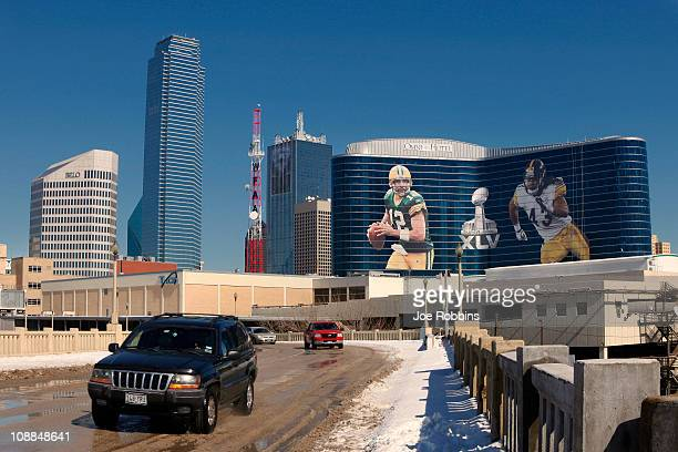General view of the downtown skyline with Super Bowl XLV art draped from the Omni Hotel as motorists make their way along on February 5 2011 in...