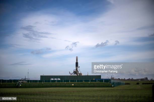 A general view of the drilling rig as people take part in a protest march at the Preston New Road site where energy firm Cuadrilla have set up...