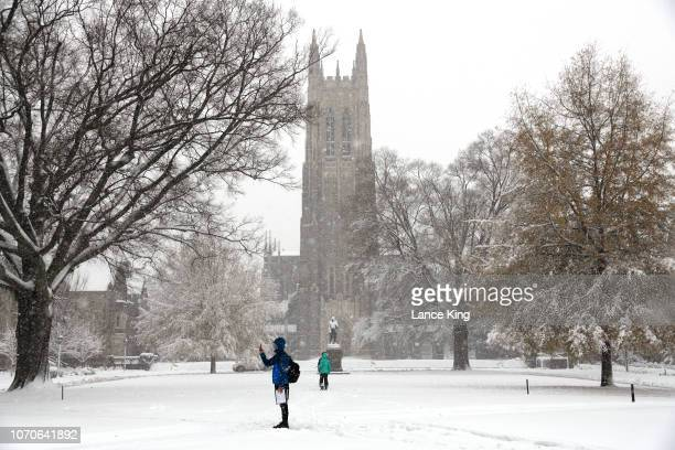 A general view of the Duke Chapel on the campus of Duke University as snow falls from Winter Storm Diego on December 9 2018 in Durham North Carolina