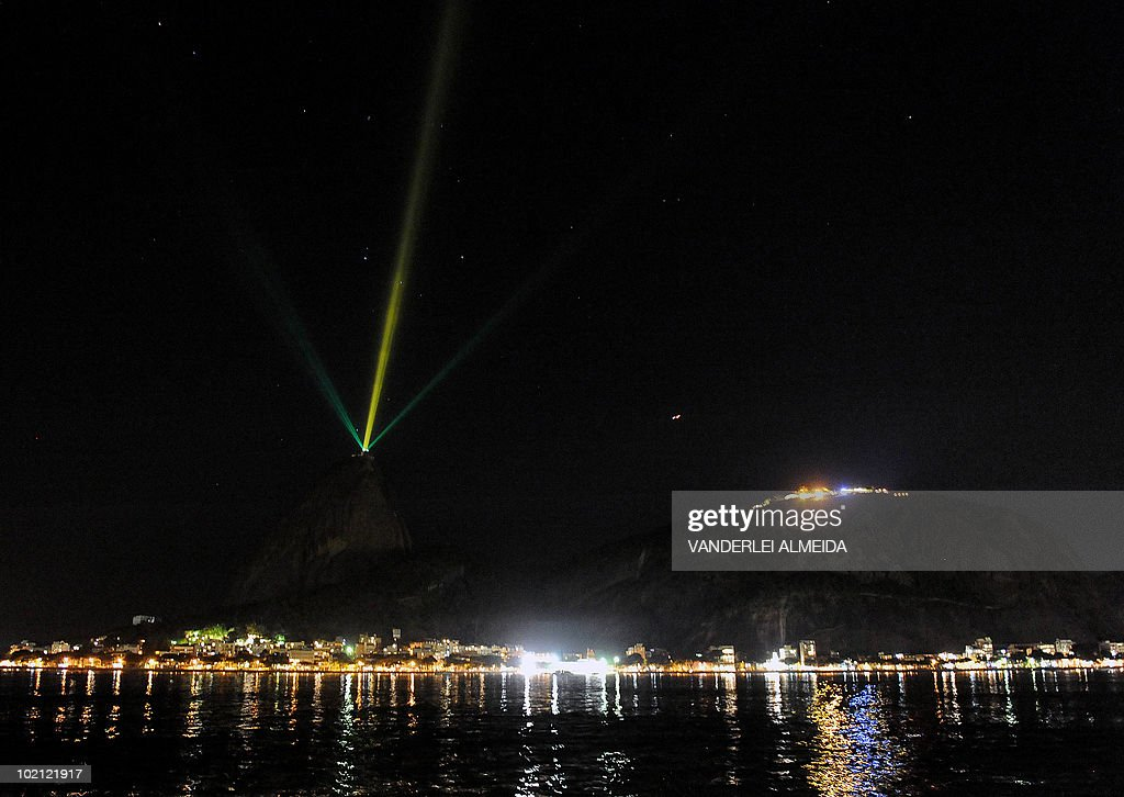 A general view of the emblematic 'Pao de Azucar' (Sugar Loaf) hill in Rio de Janeiro, Brazil emitting light beams of the Brazilian colours in celebration of their 2-1 victory over North Korea in their FIFA World Cup South Africa 2010 on June 15, 2010.