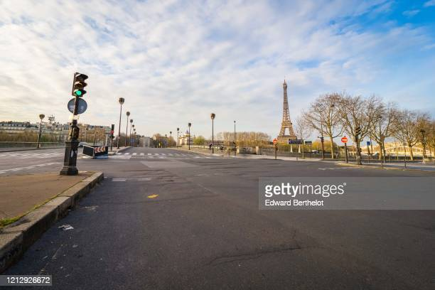 General view of the empty Alma bridge in front of the Eiffel tower while the city imposes emergency measures to combat the Coronavirus COVID19...