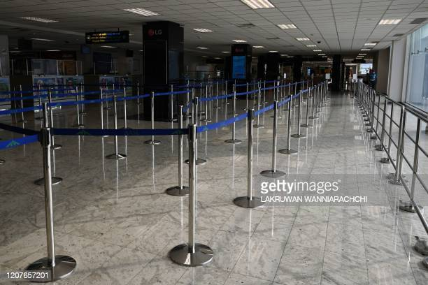 General view of the empty arrival terminal at the Bandaranaike International airport in Katunayake on March 19 following the Sri Lankan government...