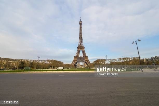 General view of the empty Champs de Mars garden in front of the Eiffel tower while the city imposes emergency measures to combat the Coronavirus...