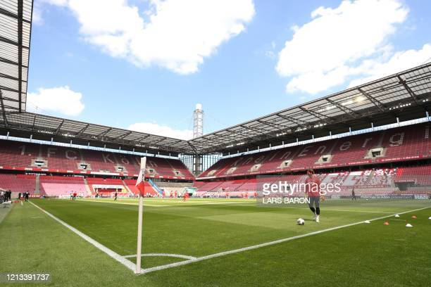 A general view of the empty RheinEnergieStadion stadium is seen during warm up prior to the German first division Bundesliga football match FC...