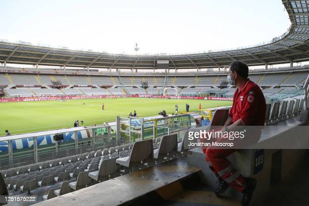 General view of the empty stadium as a member of the Red Cross is seen looking on during the warm-up before the Serie A match between Torino FC and...