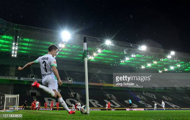 General view of the empty stadium as Patrick Herrmann of Borussia Monchengladbach takes a corner during the Bundesliga match between Borussia...
