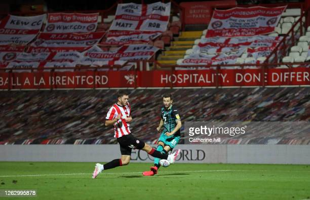General view of the empty stand filled with flags as Henrik Dalsgaard of Brentford competes with Bersant Celina of Swansea City during the Sky Bet...