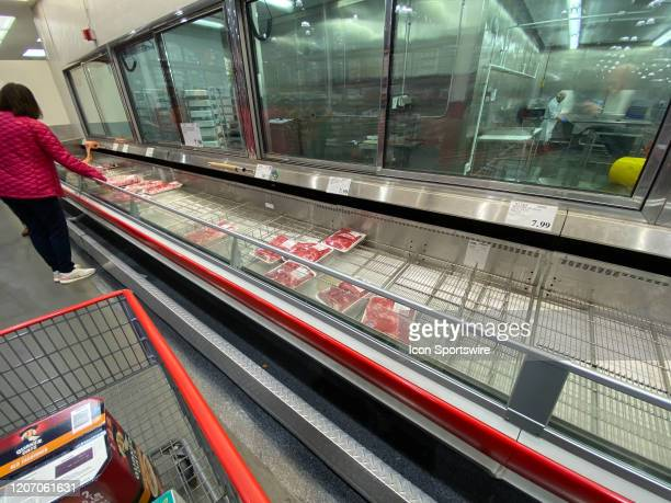 A general view of the emptying meat refrigerator cases inside of the Costco Wholesale Club on March 13 2020 in East Hanover NJ The empty shelves are...