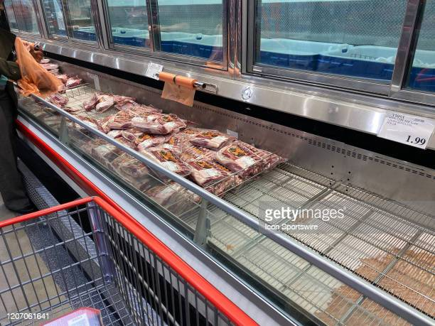 General view of the emptying meat refrigerator cases inside of the Costco Wholesale Club on March 13, 2020 in East Hanover, NJ. The empty shelves are...