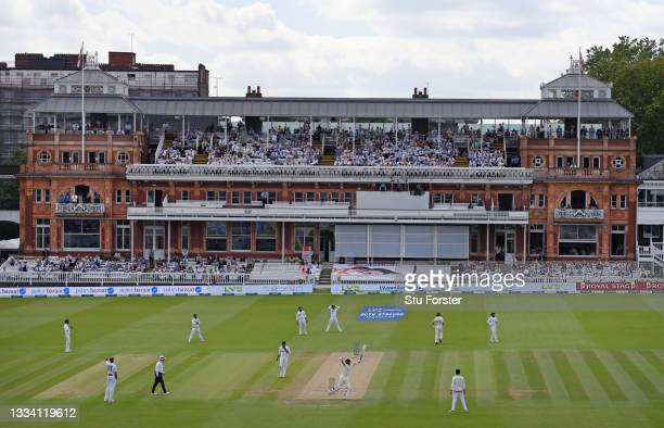 General view of the England batsman Joe Root celebrating his 100 during day three of the Second Test Match between England and India at Lord's...