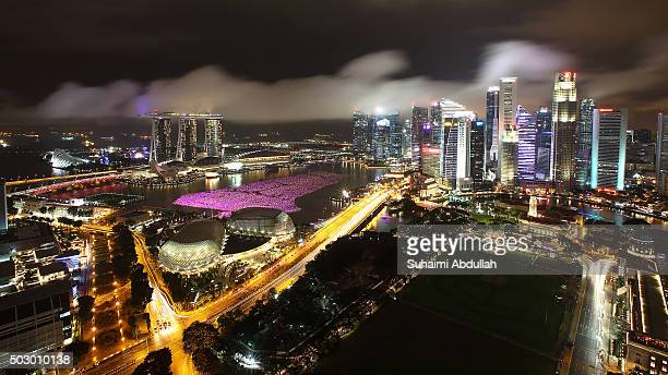 A general view of the Esplanade Marina Bay Sands Central Business District and 20000 Wishing Spheres set afloat on Marina Bay on New YearÕs Eve on...